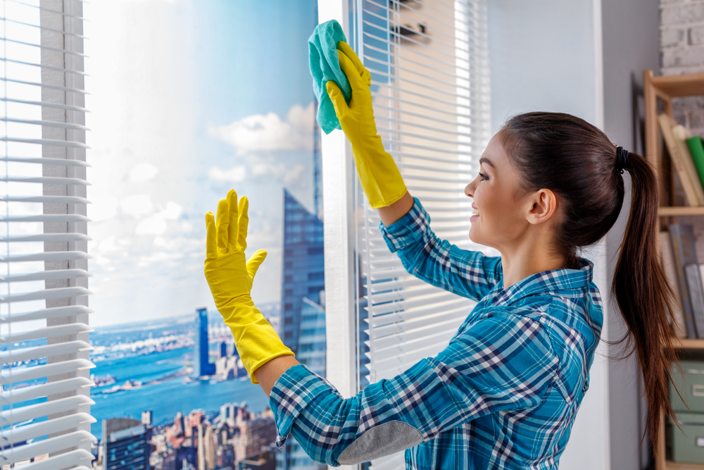 Carpet Cleaning Sunshine Coast - woman in yellow gloves