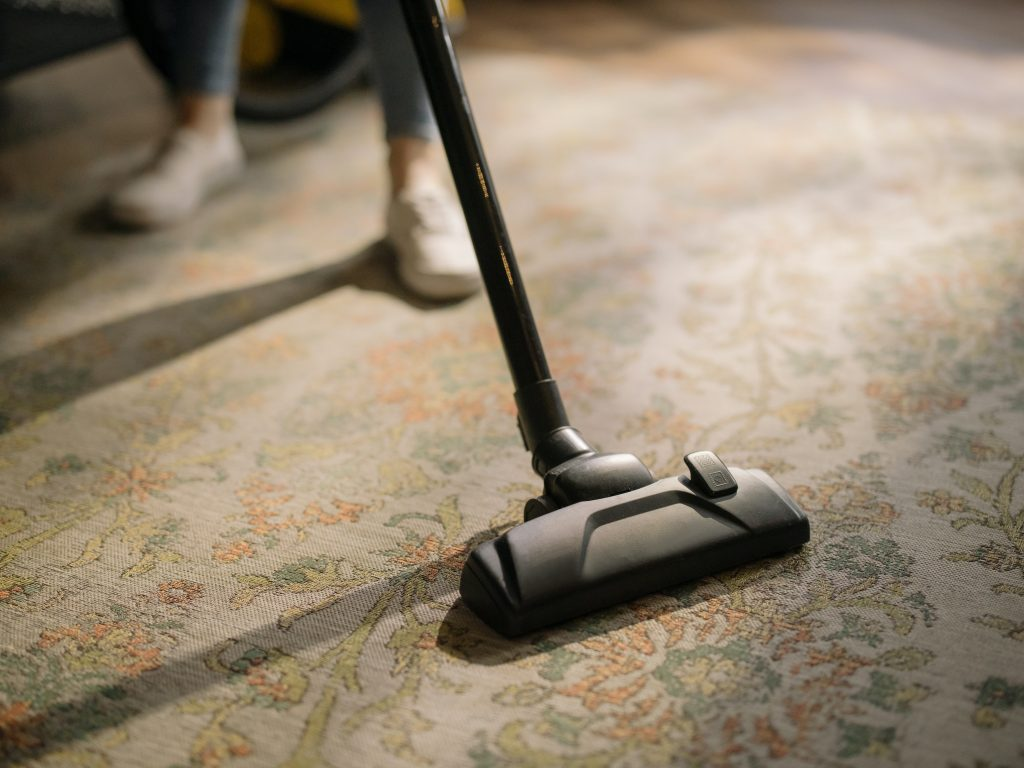 Sunshine Eco Cleaning Services - person using vacuum cleaner