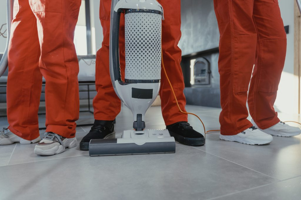Commercial Cleaning Gold Coast - people in cleaning gear with vacuum