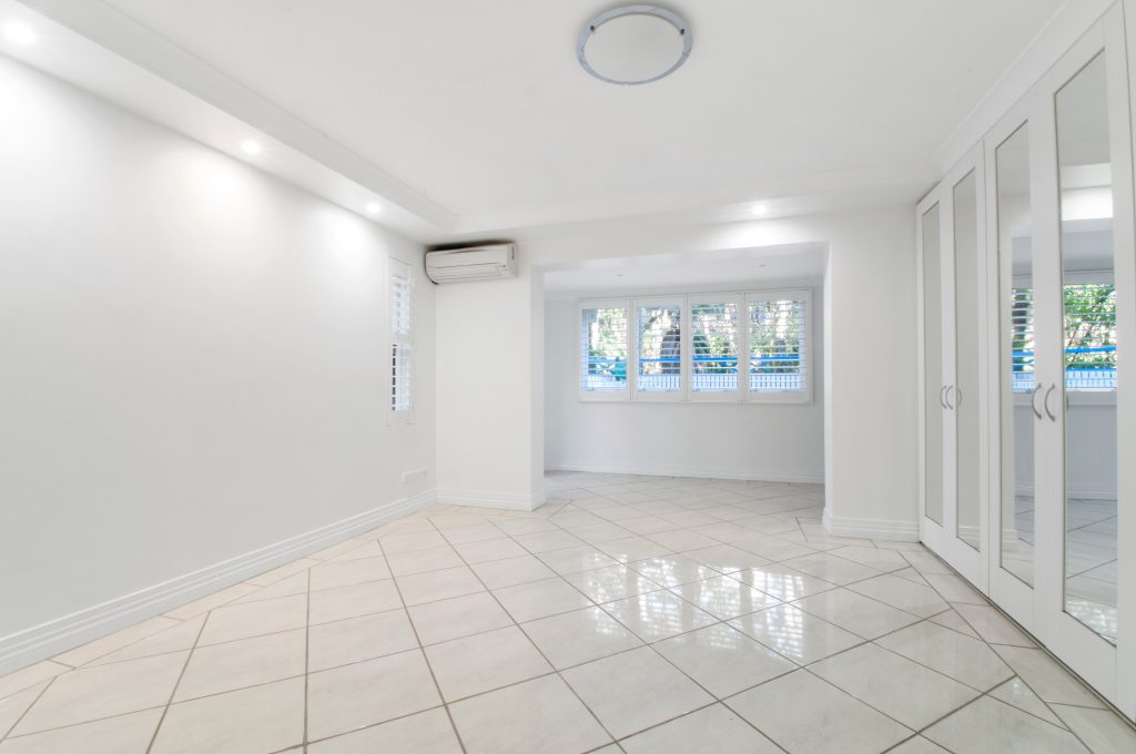 Tile and Grout Cleaning Gold Coast - clean room with white tiles and walls