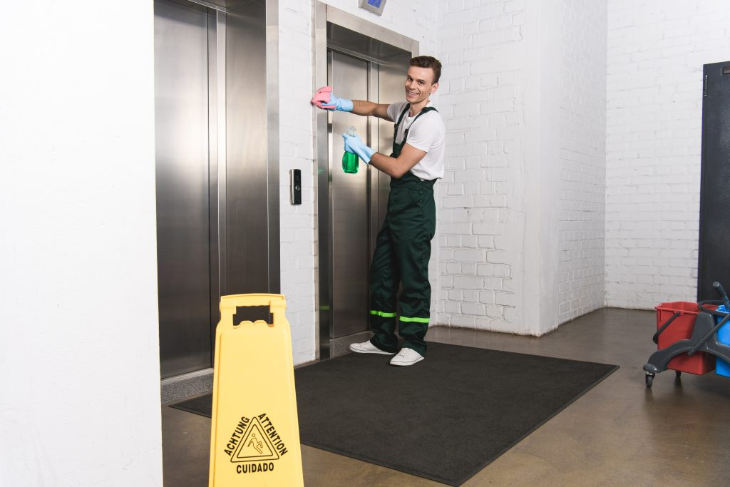 Commercial Cleaning Brisbane - man cleaning a commercial office
