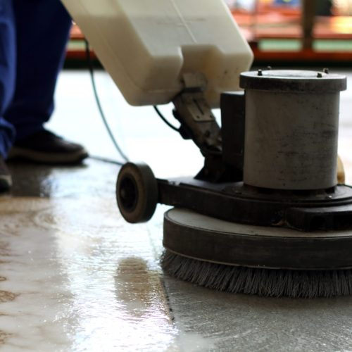 Commercial Cleaning Brisbane - person cleaning the floor in a commercial setting