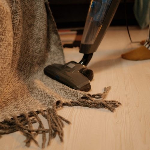 Carpet Cleaning Brisbane - person using vacuum cleaner on rug