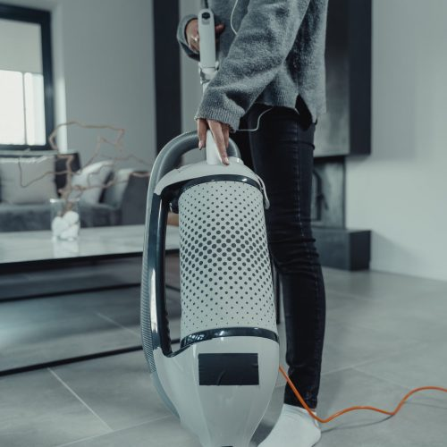Carpet Cleaning Gold Coast - person using large vacuum cleaner
