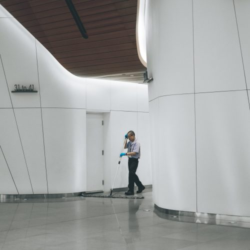 Commercial Cleaning Gold Coast - lone man cleaning large interior